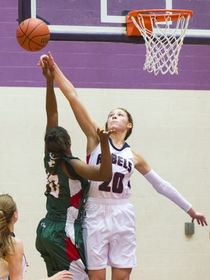 Roncalli High School junior Lindsey Corsaro (20) blocks the shot of Lawrence Central High School senior Lamina Cooper (40) during the second half of action. Corsair was called for a foul on the play. Lawrence North High School competed against Roncalli High School in the Championship game of the 2014 Marion County Girl's Basketball Tourney, Saturday, Dec. 13, 2014, at Ben Davis High School. Lawrence North defeated Roncalli 62-59.
