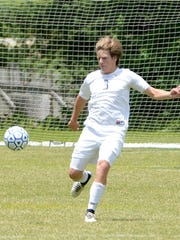 Jackson Christian's Marshall Davis prepares to pass the ball during Saturday's Class A-AA Soccer sectional against Dyersburg.