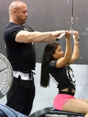 "Trainer Ismael ""Myo"" Hernandez leads Arianna Aguilar"