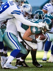 Eagles linebacker Jordan Hicks is tackled by Cowboys quarterback Mark Sanchez after an interception in the second quarter of the Philadelphia Eagles 27-13 win over the Dallas Cowboys at Lincoln Financial Field in Philadelphia, Pa. on Sunday afternoon.