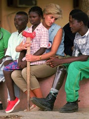 Britain's Princess Diana talks to amputees at the Neves
