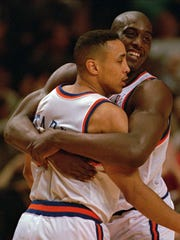 New York Knicks' Anthony Mason, right, gives teammate John Starks a bear hug in the fourth quarter Wednesday night, May 11, 1994, at New York's Madison Square Garden.  The Knicks beat the Chicago Bulls 96-91 to lead the Eastern Conference semifinal series 2-0. (AP Photo/Ron Frehm)