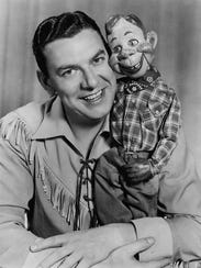 Buffalo Bob Smith and his puppet pal Howdy Doody pose
