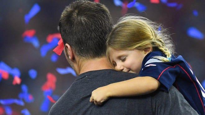 New England Patriots quarterback Tom Brady  and his daughter Vivian Brady hug after the game against the Atlanta Falcons during Super Bowl LI at NRG Stadium in Houston, Feb. 5, 2017.