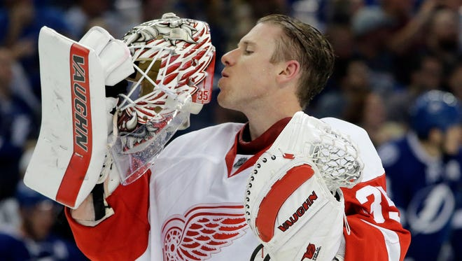 Detroit Red Wings goalie Jimmy Howard kisses his facemask during a break in the second period of Game 1 against the Tampa Bay Lightning on Wednesday, April 13, 2016, in Tampa.