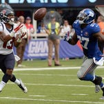 Texans wide receiver Damaris Johnson (13) catches a touchdown pass during the second half against Giants free safety Stevie Brown.