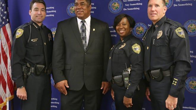 Police Chief Michael DeLeo (left) introduced Maj. Lonnie Scott, Maj. Audrey Smith and Deputy Chief Darrell Furuseth to his executive team Thursday.
