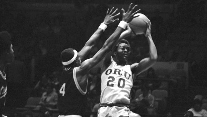 John Gunn of Memphis State, left, guards Arnold Dugger of Oral Roberts University during National Invitational Tournament basketball action, March 17, 1975, at Madison Square Garden in New York. Oral Roberts won 97-95.
