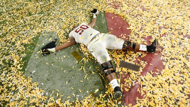 Alabama OL Alphonse Taylor celebrates after winning the College Football Playoff National Championship against Clemson in Glendale, Ariz. January 11, 2016.