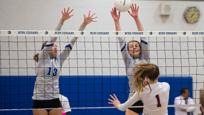 Dayna Grigsby, #2, right, and Hannah Alfes, #13, of Barron Collier jump to block a volley by Estero during the Class 7A regional quarterfinal volleyball game at Barron Collier High School on Tuesday, Oct. 25, 2016 in Naples, Florida. Barron Collier would go on to win 3-0, advancing to the regional semifinal game.