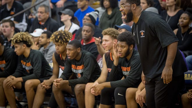 Fern Creek's head coach James Schooler encourages his team during their against Covington Catholic at the King of the Bluegrass Holiday Classic in Fairdale, Ky, Thursday, Dec. 22, 2017