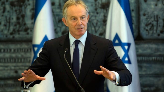 Former British Prime Minister and Mideast envoy Tony Blair gestures as he speaks during joint statements with Israel's President Shimon Peres at the President's residence in Jerusalem on July 15, 2014.