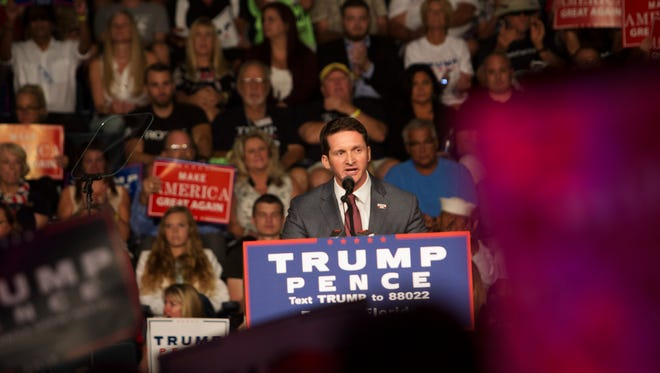 State Rep. Dane Eagle speaks at a Donald Trump rally on Monday.