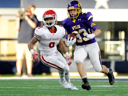 Wylie's Brady Horn (33) returns a kickoff during the