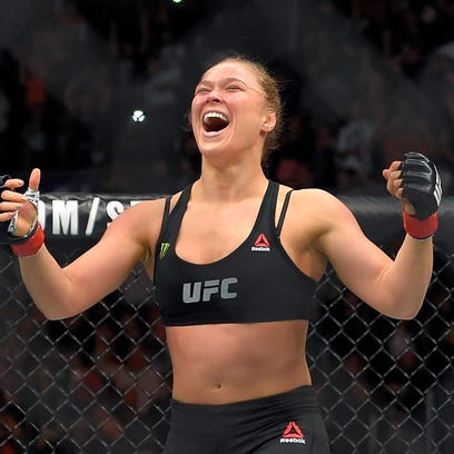 Ronda Rousey, celebrates after defeating Cat Zingano in a UFC 184 mixed martial arts bantamweight title bout, Saturday, Feb. 28, 2015, in Los Angeles. Rousey won after Zingano tapped out 14 seconds into the first round. (AP Photo/Mark J. Terrill)  ORG XMIT: LAS146