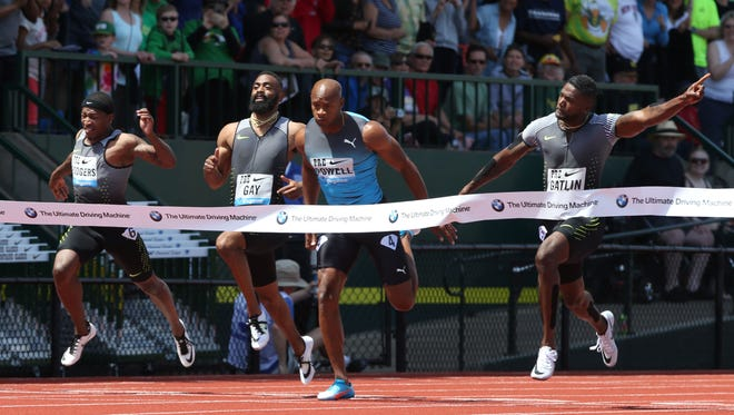 Justin Gatlin, right, wins the men's 100 meters ahead of, from left, Michael Rogers, Tyson Gay and Asafa Powell at the Prefontaine Classic athletics meet in Eugene, Ore., Saturday, May 28, 2016. (Chris Pietsch/The Register-Guard via AP)