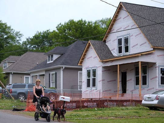 Dawn Kinnard walks through her Woodbine neighborhood.