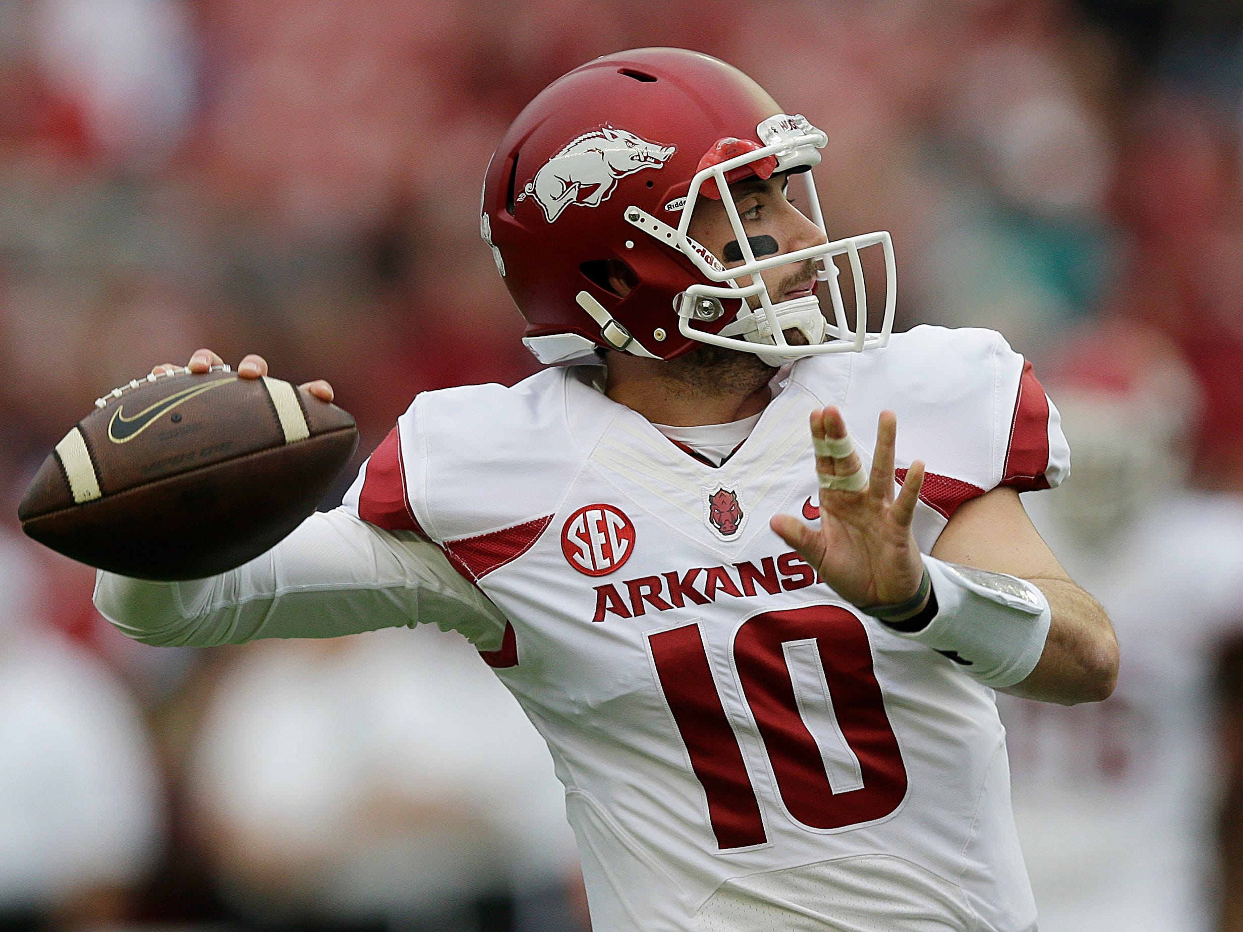 Arkansas quarterback Brandon Allen (10) sets back to pass before the first half of an NCAA college football game, Saturday, Oct. 10, 2015, in Tuscaloosa, Ala. (AP Photo/Brynn Anderson)
