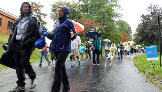 Nearly 700 people walked in the Out of the Darkness Walk raising more than $51,000 for the American Foundation for Suicide Prevention on Saturday, Oct. 8, 2016.