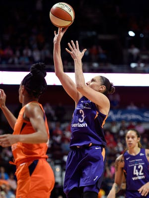 Phoenix Mercury guard Diana Taurasi shoots over Connecticut Sun defender Jasmine Thomas during the second half of a single-game WNBA basketball playoff matchup Thursday, Aug. 23, 2018, in Uncasville, Conn. (Sean D. Elliot/The Day via AP)