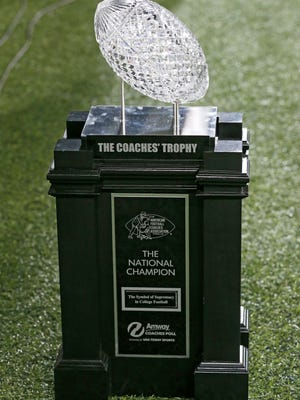 The Amway Coaches' Trophy is set up on the field during the second quarter of the NCAA college football game between the Cincinnati Bearcats and the Houston Cougars at Nippert Stadium on the University of Cincinnati campus in Cincinnati on Thursday, Sept. 15, 2016. At the half, the game was tied 10-10.