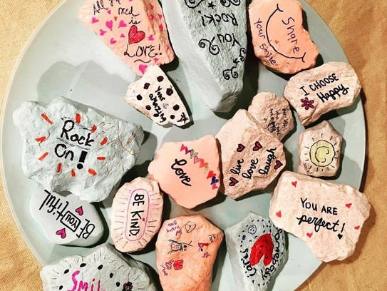 "The Girl Scouts created about 150 rocks to scatter around the Brookfield and Elm Grove area. They looked up different quotes or came up with positive messages to write on the rocks, such as ""You are perfect,"" or ""Rock on!"""