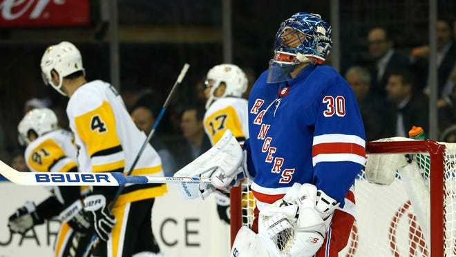 New York Rangers goalie Henrik Lundqvist (30) reacts after giving up a goal to Pittsburgh Penguins right wing Phil Kessel (81) during first period at Madison Square Garden.