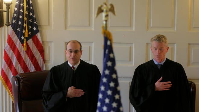 Stuart A. Minkowitz, Superior Court Assignment Judge for Morris and Sussex Counties, and Robert J. Gilson, Superior Court Appellate Division Judge, recite the Pledge of Allegiance as Morris County vicinage host its annual Law Day event at Morris County Courthouse in Morristown, NJ Monday, May 2, 2016.