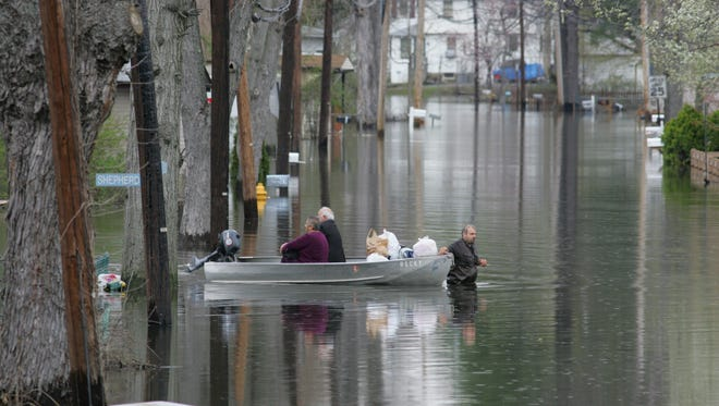 Homes on 10 Wayne streets including Fayette Avenue, shown here during a 2011 flood, were scheduled to be purchased and razed using $2.4 million in FEMA funding, officials said.