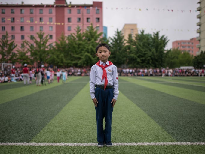 A primary school student An Jae-Gwon (10) poses for