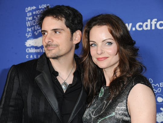 Brad Paisley, left, and Kimberly Williams-Paisley arrive