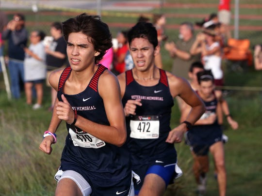 Veterans Memorial High School varsity boys Jacoby Sanchez (left) placed 11th and Sean Borchard placed fifth overall in the District 30-5A cross country meet at Dugan Track Stadium on Friday, October 13, 2017.