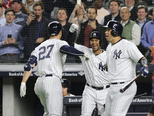 In the fourth inning Giancarlo Stanton is greeted at