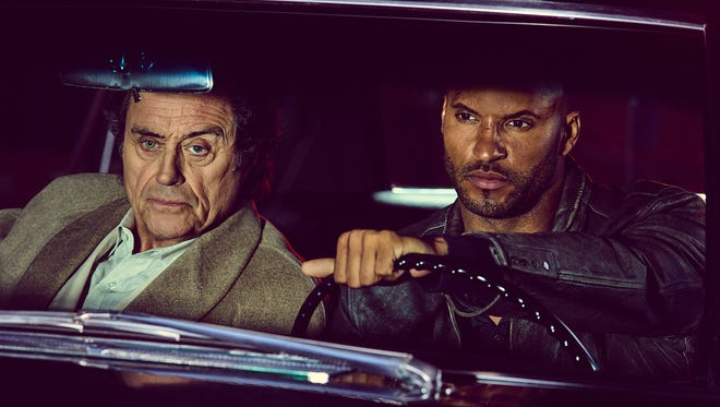 "Mr. Wednesday (Ian McShane, left) and Shadow Moon (Ricky Whittle) in a scene from ""American Gods,"" premiering in April on STARZ."
