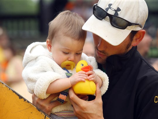 10-month-old Louisa Heerschap of Denville has a hard time giving up her duck to Dad Ryan during the 9th annual Great Denville Duck Race at Gardner Field hosted by the Denville Sunrise Rotary Club. Proceeds benefit many charitable projects sponsored by the club. June 17, 2017, Denville, NJ.