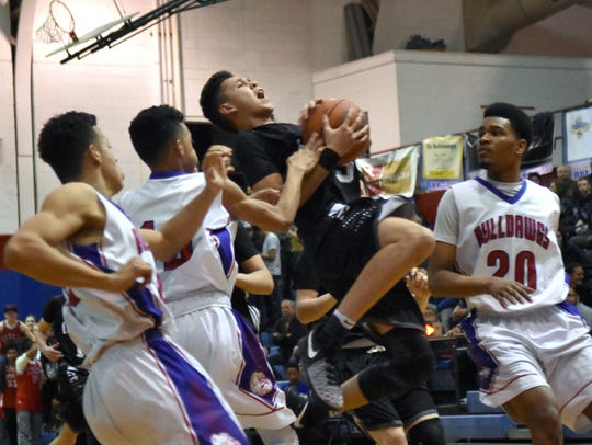OHS guard Ricky Lujan tries to go up for a shot amongst
