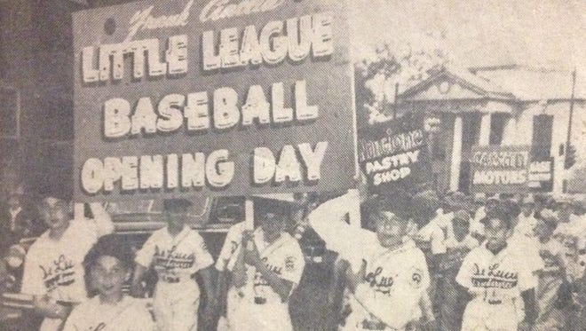 Little League players march on Saratoga Avenue, toward Edgerton Park Field, in the May 19, 1952 Opening Day parade. A total of 108 Little Leaguers, city officials and the Jefferson High School band participated in the parade.