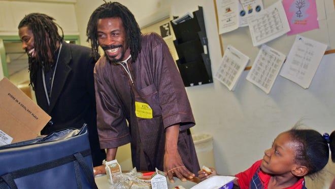 The Twin Poets, Al Mills and Nnamdi Chukwuocha work with children in Riverside.