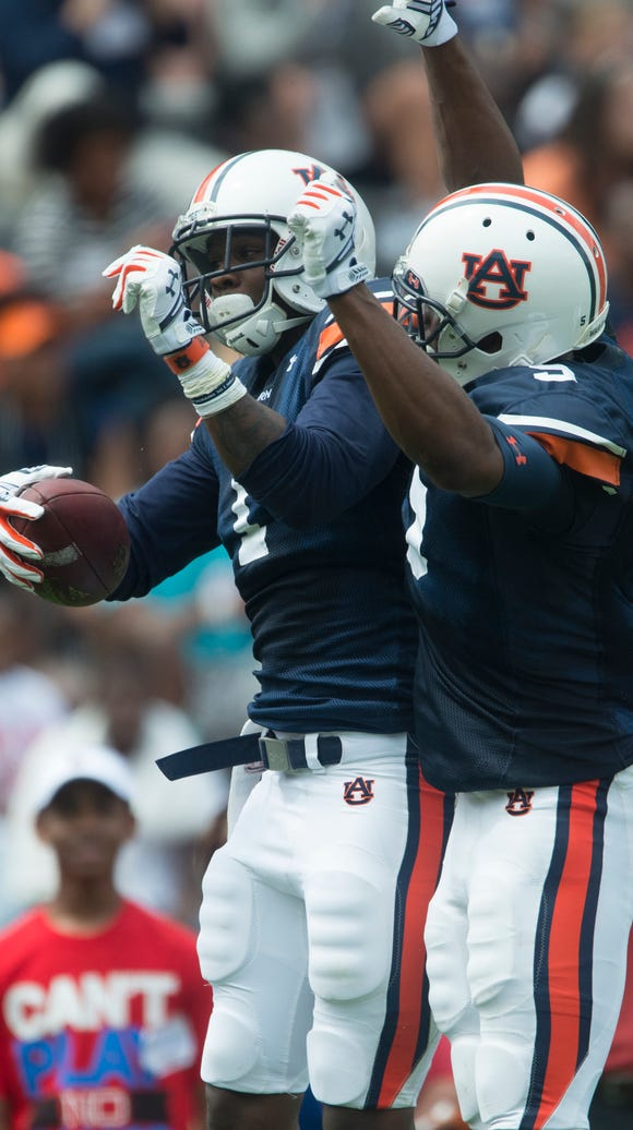 Auburn wide receiver D'haquille Williams (1) celebrates
