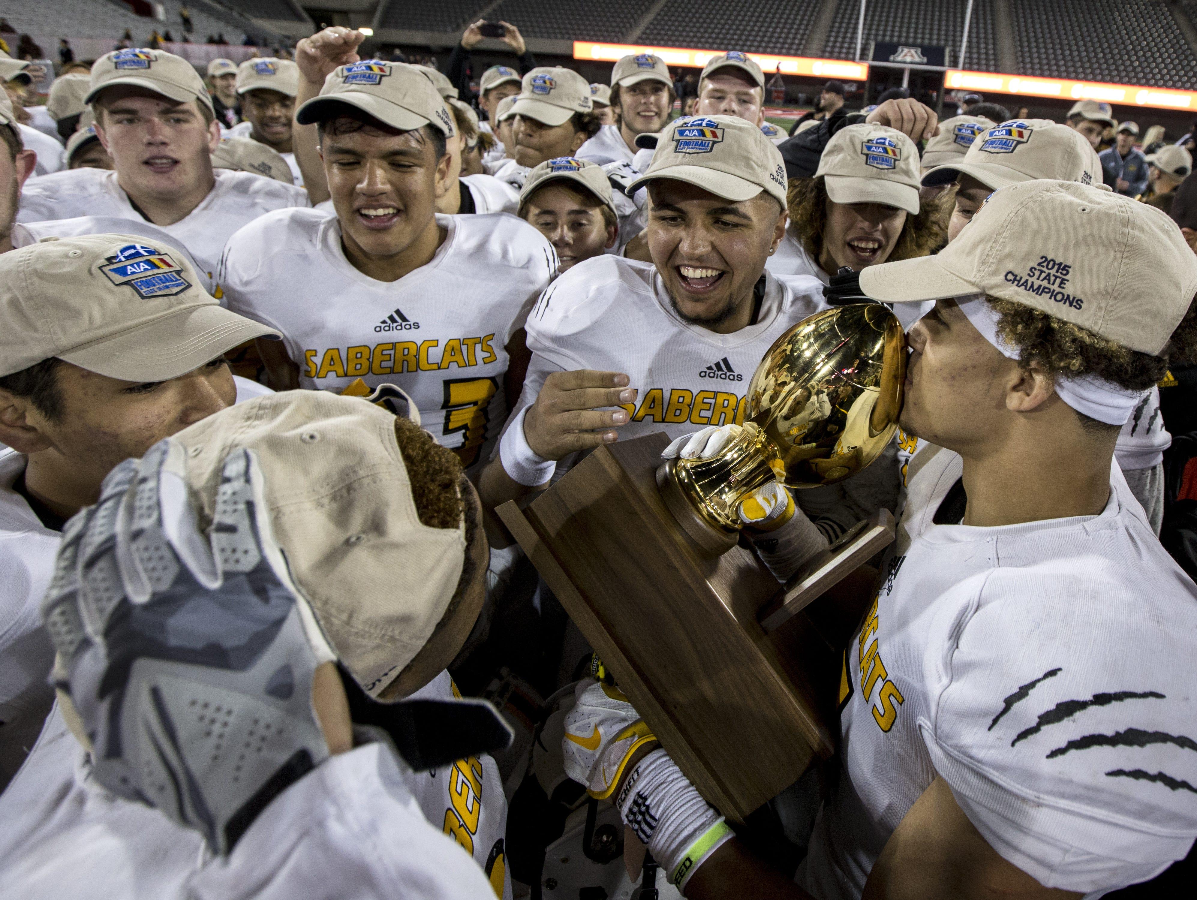 Scottsdale Saguaro celebrates after defeating Marcos de Niza for the Division II state championship on Saturday, Nov. 28, 2015 at Arizona Stadium in Tucson, Ariz. Saguaro won, 38-20.