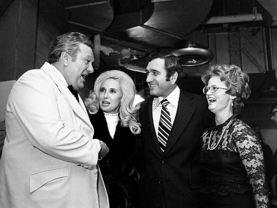 Comedian Jerry Clower, left, and songstress Tammy Wynette, two of the headline performers for the inaugural gala, greet Gov.-elect Ray Blanton and his wife, Betty, as they arrive for the festivities Jan. 17, 1975 at the Municipal Auditorium.