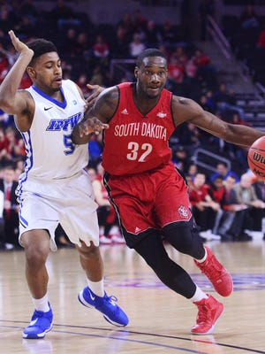 USD's D.J. Davis (32) pushes past Fort Wayne's Charles Ruise Jr. (5) with the ball in a Summit League basketball men's quarterfinal Saturday at the Denny Sanford Premier Center, Mar 5, 2016.