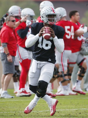 Ohio State quarterback J.T. Barrett (16) practices at Notre Dame Preparatory High School in Scottsdale. Ohio State will play Clemson in the Fiesta Bowl National Semifinal game.