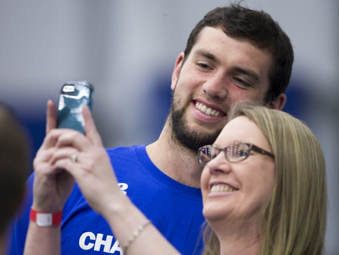 Andrew Luck, Colts quarterback, poses for a selfie with Dr. Abby Klemsz, a neuro disabilities doctor at Riley Hospital for Children, during a fitness-themed event called Change the Play at the Indiana Farm Bureau Football Center, Indianapolis, Friday, April 18, 2014.