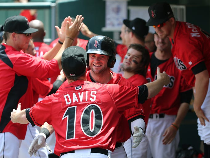 Indianapolis Indians batter Matt Hague celebrates with teammate Blake Davis after hitting a three-run home run against the Gwinnett Braves at Victory Field, Sunday, June 15, 2014, in Indianapolis.