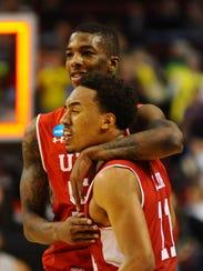 Utah Utes guard Delon Wright (back) and guard Brandon
