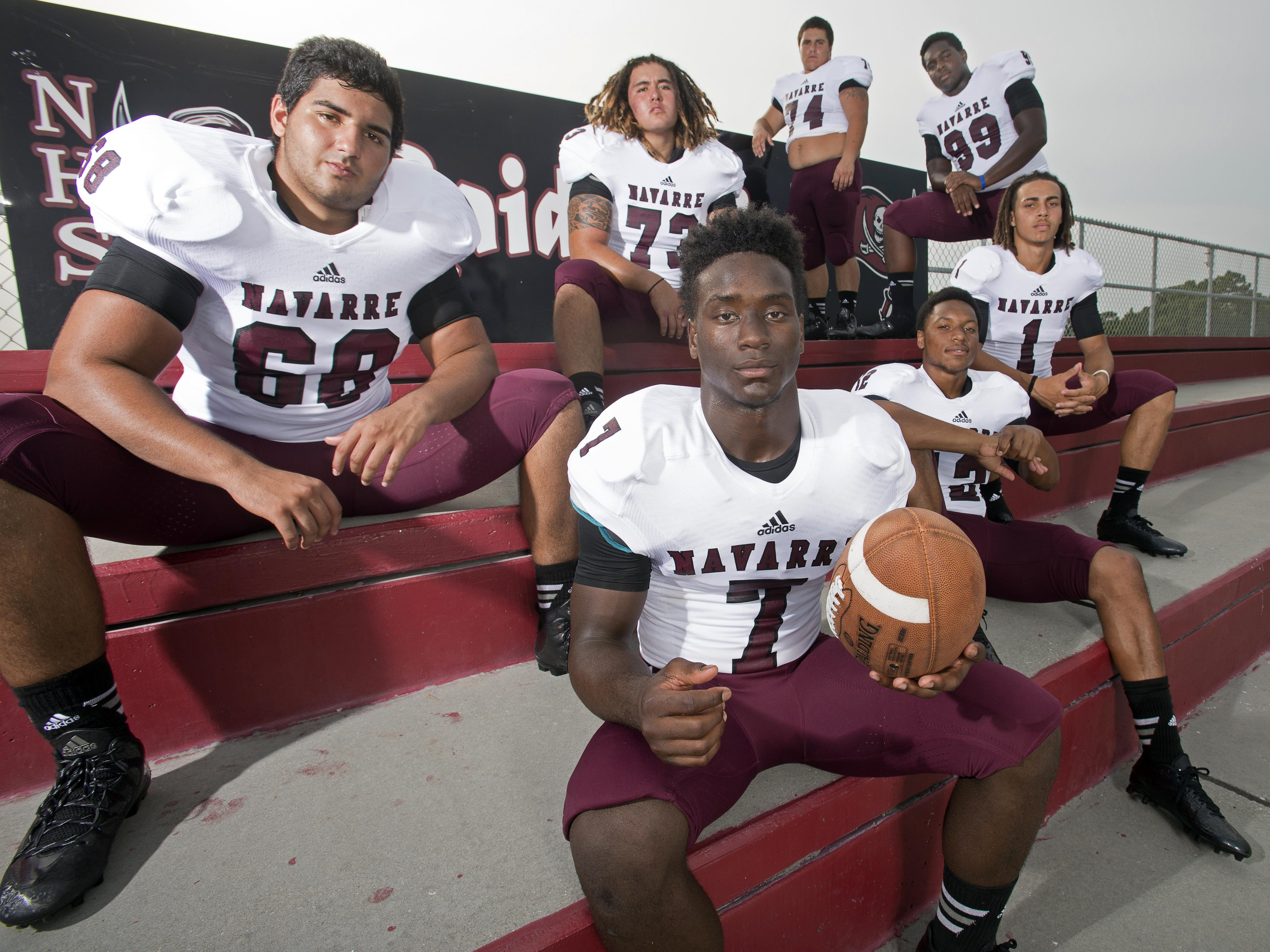 Navarre Football's impact players return to the squad this season are L to R: Nick Brahms (68), Corey Capenia, Michael Carter (7), Brent Short (74), Michael Sandle (12), Anthony Miller (99) and Thomas Leggett (1).