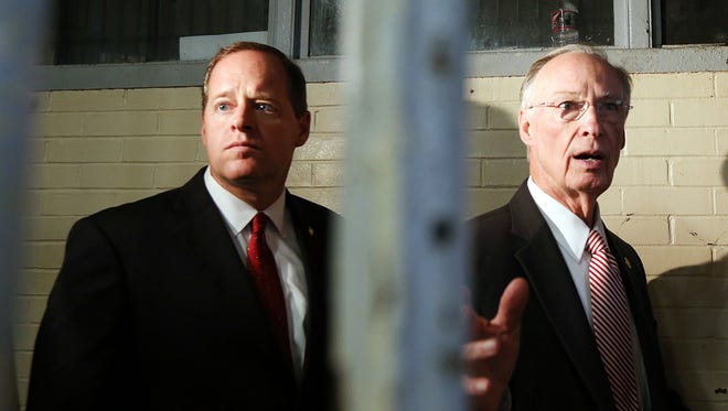 Alabama Gov. Robert Bentley, right, and state Sen. Cam Ward, look through prison bars into a dormitory at Holman Prison in Atmore, Ala., while on a tour of the facility with Prison Commissioner Jeff Dunn and other officials Tuesday, March 15, 2016. Two disturbances have occurred in the last three days at the maximum security prison designed to house 637 inmates. The current population at Holman is 991, which is 156% of design capacity.