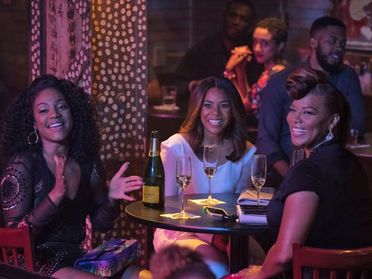 "Tiffany Haddish, left, plays a member of the ""Flossy Posse"" in 'Girls Trip.'"