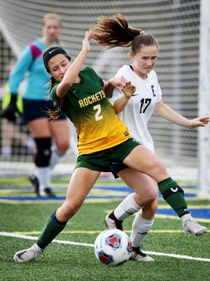 Reynolds' Pali Smith tries to take control over the ball as Roberson's Caroline Allison guards March 28, 2018, at Roberson High School. Reynolds won, 1-0.